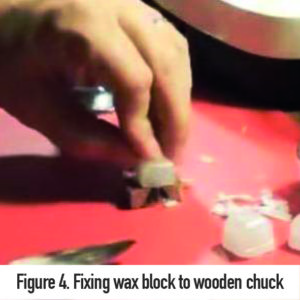 Fixing wax block to wooden chuck